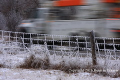 Speeding past Beauty (Herman Bresser:) Tags: winter snow blur ice speed fence outdoors frozen post outdoor winterscene