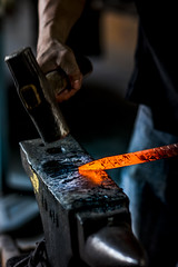 Hit when hot (kajohnwit) Tags: old man hot metal hammer fire fan chains hit iron industrial hand handmade antique metallic steel traditional country rustic gray craft smith retro equipment burning flame workshop heat metalwork strike glowing worker manual ironwork blacksmith forge tongs coal heavy craftsman tool flaming handwork anvil craftsmanship molten skill smithy forging hoary