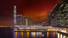 Red Sky over Kowloon (Bernhard Sitzwohl) Tags: china city longexposure travel urban hk reflection skyline night skyscraper hongkong cityscape harbour citylights stadt architektur sha kowloon stacked yau tsim tsui mong parkdeck hafenviertel