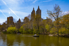 City Moods (Joyce and Steve) Tags: newyorkcity blue brown sun lake sunshine boat spring cityscape centralpark upperwestside rowboat