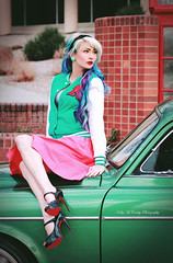 Nostalgia (Kelly McCarthy Photography) Tags: pink woman green beautiful beauty car fashion vintage volvo model highheels makeup style skirt retro jacket blonde heels earrings bluehair pinup headband purplehair volvo122 catchycolorsgreen catchycolorspink colorfulhair lettermanjacket