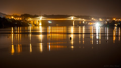 Code of silence (OR_U) Tags: uk longexposure nightphotography bridge sea orange reflection water yellow wales night gold lights code nightlights widescreen le barcode oru billyjoel 169 anglesey 2016 menaistrait menaibridge