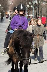 Girls on horseback (bokage) Tags: street horse child sweden stockholm helmet riding kungstrdgrden bokage