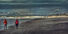 Day Glow (emptyseas) Tags: ocean people usa sun beach clouds sand nikon day glow shadows florida shade hotels cocoa joggers d800 emptyseas