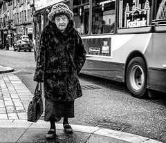 One 'fur' the album. (Mister G.C.) Tags: street old people urban blackandwhite bw woman monochrome hat lady female fur scotland eyecontact europe sad expression glasgow candid coat streetphotography sigma elderly unposed schwarzweiss frail 30mm strassenfotografie 30mmf28dn sonya6000 mistergc