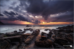Nubes tormentosas en Barrika (Caramad) Tags: longexposure light sunset sea seascape water marina landscape mar spain agua rocks playa olas bizkaia euskadi rocas wate barrika marcantbrico