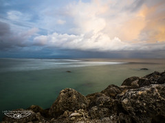 STORMY SEA LONG EXPOSURE (laith_stevens) Tags: ocean longexposure sunset sea orange storm clouds rocks waves smooth tropicalisland whitewash nauru centralpacific