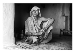 a grandmother's gaze (handheld-films) Tags: old travel portrait people blackandwhite woman india home female mono women village grandmother interior indian documentary doorway domestic elderly portraiture aged subcontinent rurallife madhyapradesh