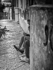 Girls-phone-street (Gaetano Serio) Tags: blackwhite streetphotography streetportrait olympus palermo zuiko 45mm biancoenero mirrorless olympusomdem5 omdem5