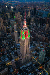 Toy Skyscraper (Justin in SD) Tags: christmas city nyc newyorkcity winter portrait holiday ny newyork color building night skyscraper high cityscape candy dusk manhattan fast aerial midtown helicopter citylights highrise resolution empirestatebuilding empirestate candycane aerialphotography height highiso redandgreen highquality sonyalpha sonya7rii a7rii a7r2