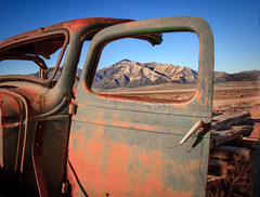 The Window View (http://fineartamerica.com/profiles/robert-bales.ht) Tags: people mountains ford beautiful vintage spectacular landscape photo junk rust desert antique awesome nevada rustic rusty surreal peaceful places super retro nostalgia chrome transportation vehicle sensational headlight states grille chassis windshield oldcar sublime buldings rollinghills collector modelt classictruck ponyexpress haybales scenicphotography oldcarandetc robertbales oldpickupoldtruck oldcollectable schellbouonestation