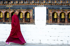 Young monk at the Thimphu Dzong, Bhutan (Gabriela Iacobuta) Tags: wood red colour child singing bhutan walk buddhist prayer pray ngc wheels young monk buddhism monastery sing dzong tradition thimphu 5photosaday lprepeat