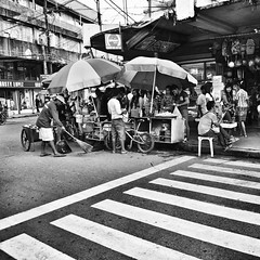 Street food in Tacloban City - the Philippines (40emem) Tags: street city people bw food white black umbrella lumix flickr philippines pedestrian olympus sidewalk bnw f25 ep3 leyte tacloban 14mm