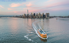 Sunset Skyline and Ferry (DSC01628) (Michael.Lee.Pics.NYC) Tags: sunset newyork reflection cityscape sony worldtradecenter aerial helicopter lowermanhattan statenislandferry newyorkharbor onewtc flynyon zeissbatis25mmf2 a7rm2