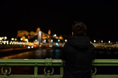 Budapest (ffruzsi.) Tags: life street city bridge boy urban black green castle water night river dark walking outside liberty photography 50mm lights evening town spring still nikon hungary waterfront view bokeh outdoor budapest human april nikkor chill danube buda pest springtime 2016 d5100