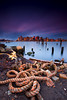 Boston Skyline from East Boston Shoreline with Nautical Rope and Decayed Pier at Sunrise (Greg DuBois - Sponsored by LEE Filters) Tags: ocean wood old city longexposure blue red sea sky urban cloud seascape motion blur reflection water boston skyline architecture clouds sunrise buildings photography coast pier photo movement colorful downtown cityscape photographer waterfront purple photos decay massachusetts stock smooth shoreline newengland rocky surreal wallart rope historic atlantic east shore prints pilings nautical pylons northeast decayed waterscape eastboston neutraldensity loprestipark leefilters bigstopper carltonswharf gregdubois