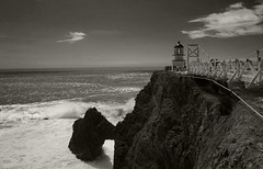 Point Bonita Lighthouse (jeffho830) Tags: bridge cliff lighthouse blackwhite sunny splash bigwave pointbonitalighthouse
