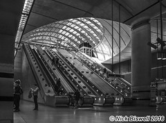 Canary Wharf Underground Station (Nick Biswell) Tags: uk blackandwhite london monochrome underground sony handheld docklands londonunderground canarywharf photocompetition canarywharfstation nothdr a580 buckinghamcameraclub tamrondt18270mmf3563 bccpoty2016round3open cameraclubconpetition