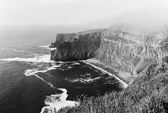 Cliff of Moher 08 (Ian Atrus Gazzotti  iangazzotti.com) Tags: ocean ireland sea blackandwhite bw water monochrome analog 35mm nikon cliffs bn moher biancoenero irlanda scogliere f70
