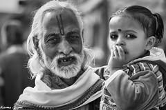 Grandfather's love (karmajigme) Tags: street travel blackandwhite india man girl monochrome nikon noiretblanc grandfather streetphotography human varanasi
