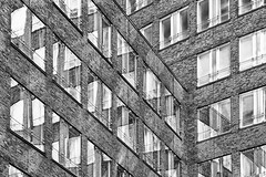 Untitled (Einherjar2k8) Tags: city windows blackandwhite abstract glass stone architecture facade hamburg brickwork rightangle intersecting