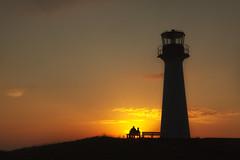 Ritual at Dusk (Renald Bourque) Tags: sunset lighthouse nature sunrise ciel cielo dust coucherdesoleil romantique bancpublique îlesdelamadeleine fabuleuse
