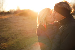 Live. Laugh. Love. (thethomsn) Tags: autumn winter light sunset woman man love face backlight germany happy countryside kiss kissing couple dof bright live joy meadow warmth sigma husband jacket laugh blonde flare older wife dreamy goldenhour sunflare 30mm warmness primelens goldcolored thethomsn