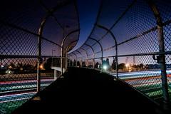 Safe Passing (ATOM1_Productions) Tags: california ca longexposure bridge urban lightpainting cali night lowlight nocturnal sony noflash lighttrails nightscene huntingtonbeach a7 surfcity sonya7 overthe405freewayhb