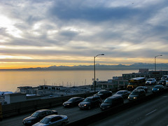 Rush Hour (prima seadiva-moving slow) Tags: sunset sky mountains clouds traffic market viaduct olympics pikeplace img commuters elliotbay victorsteinbrueckpark