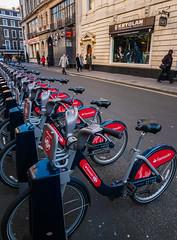 Row of hire bicycles (Covent Garden) (Panasonic Lumix LX100 Compact) (markdbaynham) Tags: street leica city uk urban london westminster lumix zoom capital central panasonic gb fixed metropolis dmc compact lx londoner londonist lx100 2475mm f1728 lumixer