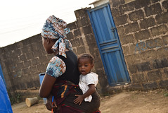 MOTHER AND CHILD. Akan-un-laara, Ikorodu, 2015. (cadi.cliff) Tags: africa travel portrait people woman baby west wall gate child faces state mother photojournalism lagos doorway westafrica nigeria activism motherandchild wrapper socialchange portraitphotography ikorodu youthdrivenchange