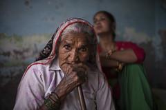 Intense Gaze (Ravikanth K) Tags: old red two portrait india green look intense eyes women sitting outdoor pipe environmental smoking sit balance gaze hookah bangles pradesh uttar 500px nandgaon