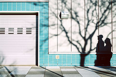 Two Worlds (reinfected) Tags: street new york blue shadow abstract color building tree silhouette facade walking photography couple shadows candid garage cyan minimal minimalism alternative silouhette alternate mnml sillohette