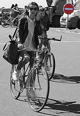 Cute in bicycle (patrick_milan) Tags: street people blackandwhite bw woman white black cute girl monochrome bicycle noir noiretblanc nb cycle rue blanc velo personne streetview gens mignonne