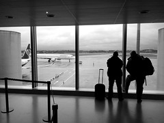 easygoing (vfrgk) Tags: windows people blackandwhite bw monochrome airplane landscape airport duo watching guys luggage traveling littlepeople staring departure easygoing