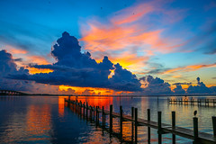 Colorful Indian River Sunrise (tclaud2002) Tags: blue sky orange usa sun color bird nature water weather clouds sunrise canon outside outdoors photography pier photo dock colorful florida cloudy photograph indianriver jensenbeach 70d