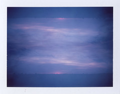 Muted Glow (benjaflynn) Tags: pink sunset sky storm film weather clouds analog vintage dark polaroid outside outdoors iso100 evening colorful pattern fuji view cloudy dusk antique doubleexposure horizon overlay retro multipleexposure mirrored fujifilm thunderstorm trippy psychedelic bellows manualfocus instantcamera pola cloudporn underexposed discontinued muted rotated severe gloaming clouded overlap landcamera roid eyecatching packfilm opensky foldingcamera instantfilm instantprint scannedfilm primelens fujiroid sunsetporn fp100c skyporn polalove fixedfocallength peelapartfilm epsonperfectionv500 polaroidlandcameraautomatic230 auto230 benseidelman polaroid114mmf88lens
