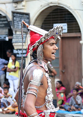 Perahera Portrait (IMG_3562b) (Dennis Candy) Tags: street portrait man heritage face youth costume day profile culture buddhism dancer parade srilanka ceylon procession tradition serendipity pageant hinduism kandy ves headgear perahera serendib serendip esala