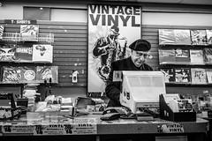 Checkout (Ben at St. Louis Energized) Tags: city urban blackandwhite monochrome stlouis albums recordstore stl vintagevinyl delmarloop