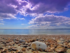 Playing with filters again (real glass ones, no Photoshop) (davegeorgecooper) Tags: blue sea beach purple potd pebble filter portsmouth seafront cloudscape southsea picoftheday