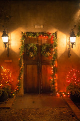 New Mexico Christmas ([ raymond ]) Tags: christmas door light newmexico santafe night festive entrance garland wreath lanterns entry canyonroad img1785