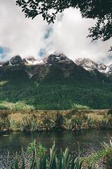 Entering Fiordland (Sean Lowcay (sealow08)) Tags: newzealand sky cloud mountain lake snow nature water river landscape nikon scenery rocks natural outdoor rocky nz southisland d90 nikond90