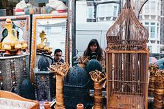 Bristol; January 2016 (Daniel Durrans) Tags: street urban woman man reflection birdcage shop lady bristol mirror streetphotography lamps junkshop antiqueshop vintageshop curioshop vsco