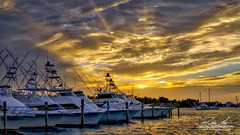 Sailfish Marina Sunset (srotag1973) Tags: ocean sunset orange sun seascape water boats boat hdr sportfish