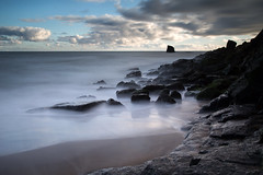 In the cold light of day (Griff~ography) Tags: sky water clouds see bay coast movement sand rocks long exposure yorkshire le whitby saltwick