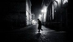 Into the Night | Day 223 / 365 (marcin baran) Tags: street light shadow people blackandwhite bw white man black blur building monochrome mystery night composition speed dark walking person evening blackwhite movement blurry darkness pov walk ghost go streetphotography poland polska going move human mysterious lamps 365 element gliwice x100 365project marcinbaran x100t