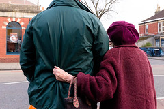 Bristol; March 2016 (Daniel Durrans) Tags: road street urban man hat lady bristol hand streetphotography jacket oldlady oldwoman handbag anorak horfield