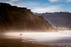 The Surfer (Steffen Walther) Tags: california travel usa mist canon waves pacific sandiego surfer lifestyle lajolla shore westcoast blacksbeach canon70200 fotografjena steffenwalther