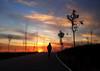 tarde de invierno (mesana62) Tags: street sunset red sky orange sun girl silhouette skyline backlight spain europe shadows samsung seville explore cielo invierno 500 rosana exploration marzo 250 orton nwn cylon13