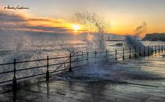 Piering between the waves (Bev Cappleman) Tags: sea seascape sunrise waves wave seawall whitby splash breakingwave roughsea whitbypier